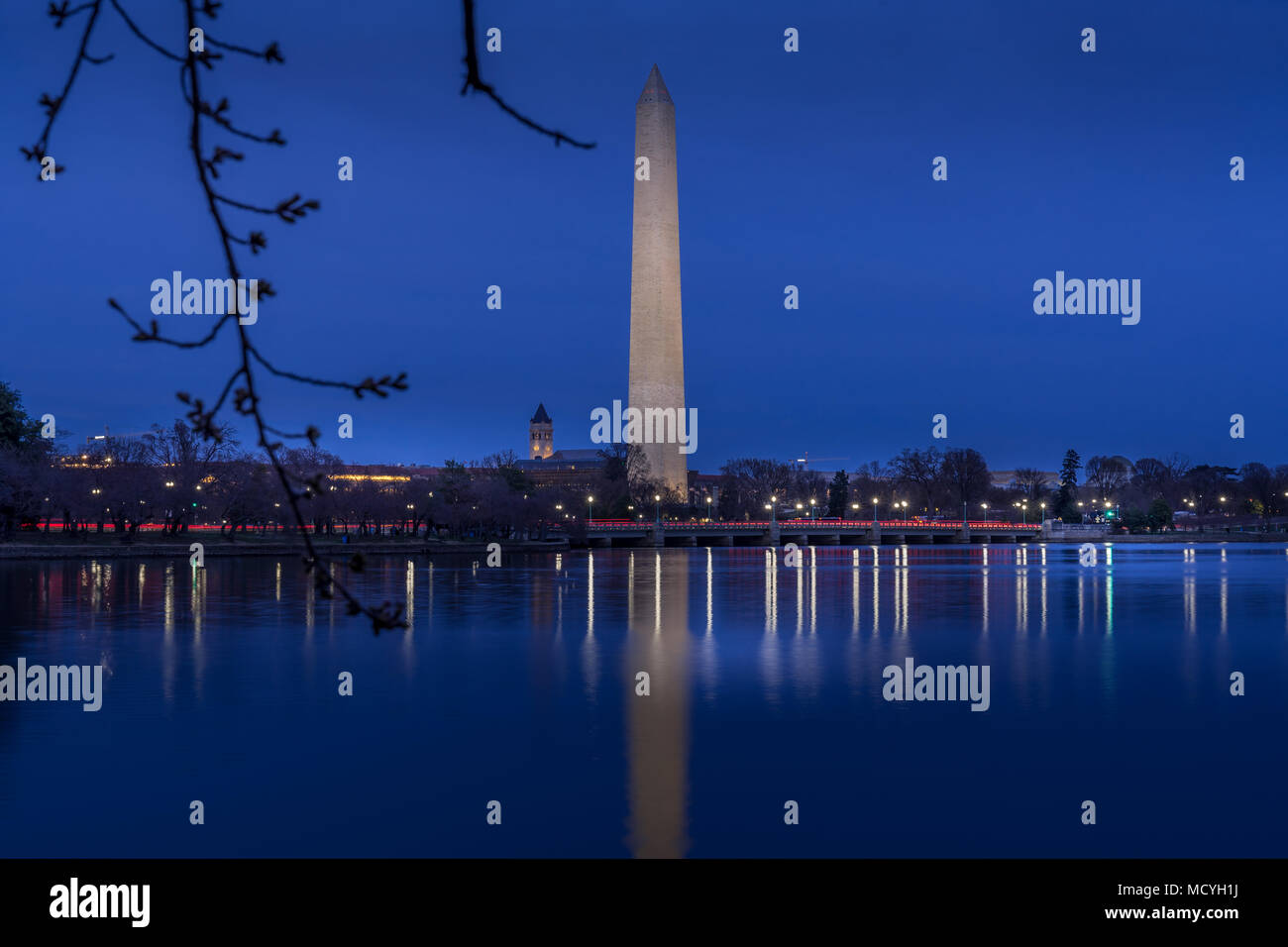 Washington DC. USA - March 24, 2018. Beautiful view of Washington Monument in twilight scene with reflection in the water - Stock Image