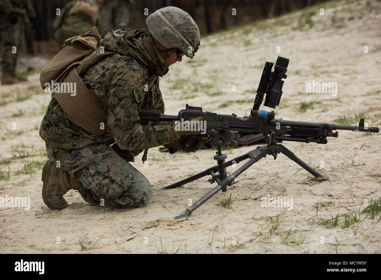 A U.S. Marine with Company L, 3rd Battalion, 2nd Marine Regiment, 2nd Marine Division, inspects a M240B machine gun before conducting a live-fire platoon attack on the new G29 range on Camp Lejeune, N.C., March 6, 2018. 2nd Marine Division provided funding and material for the creation of G29, then used 2nd Combat Engineer Battalion equipment and operators to finalize the production of the range. (U.S. Marine Corps photo by Pfc. Nathaniel Hamilton) - Stock Image