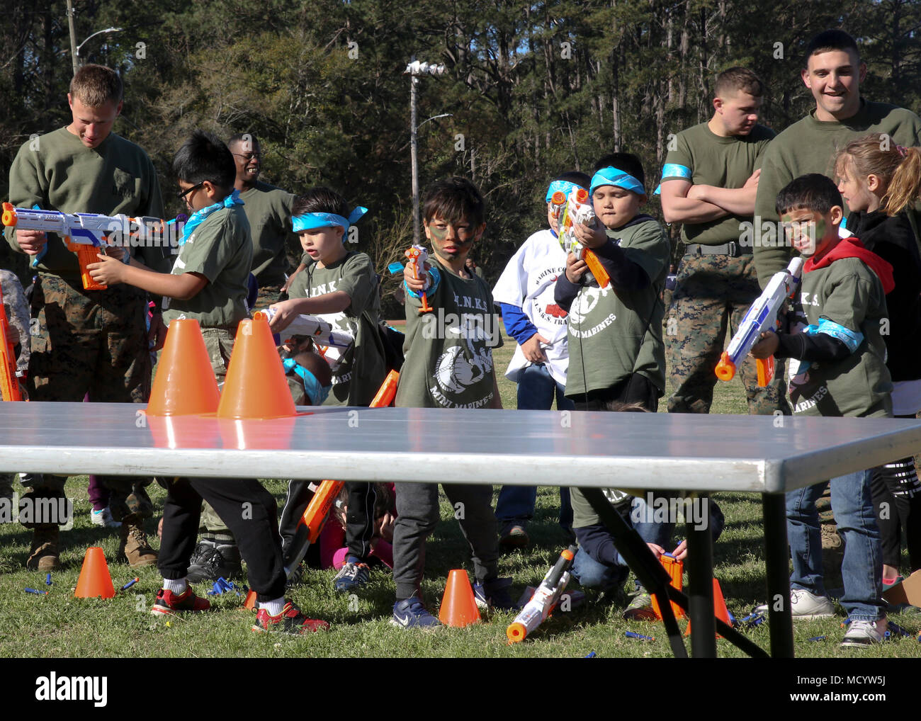Children take aim at the toy rifle range during Mini Marines aboard Marine Corps Air Station Beaufort, March 3. The event was hosted by Marine Corps Community Services South Carolina to show the children what their parents do at work. The event also featured a mock CFT, a sack race and a Marine Corps Martial Arts Station. - Stock Image
