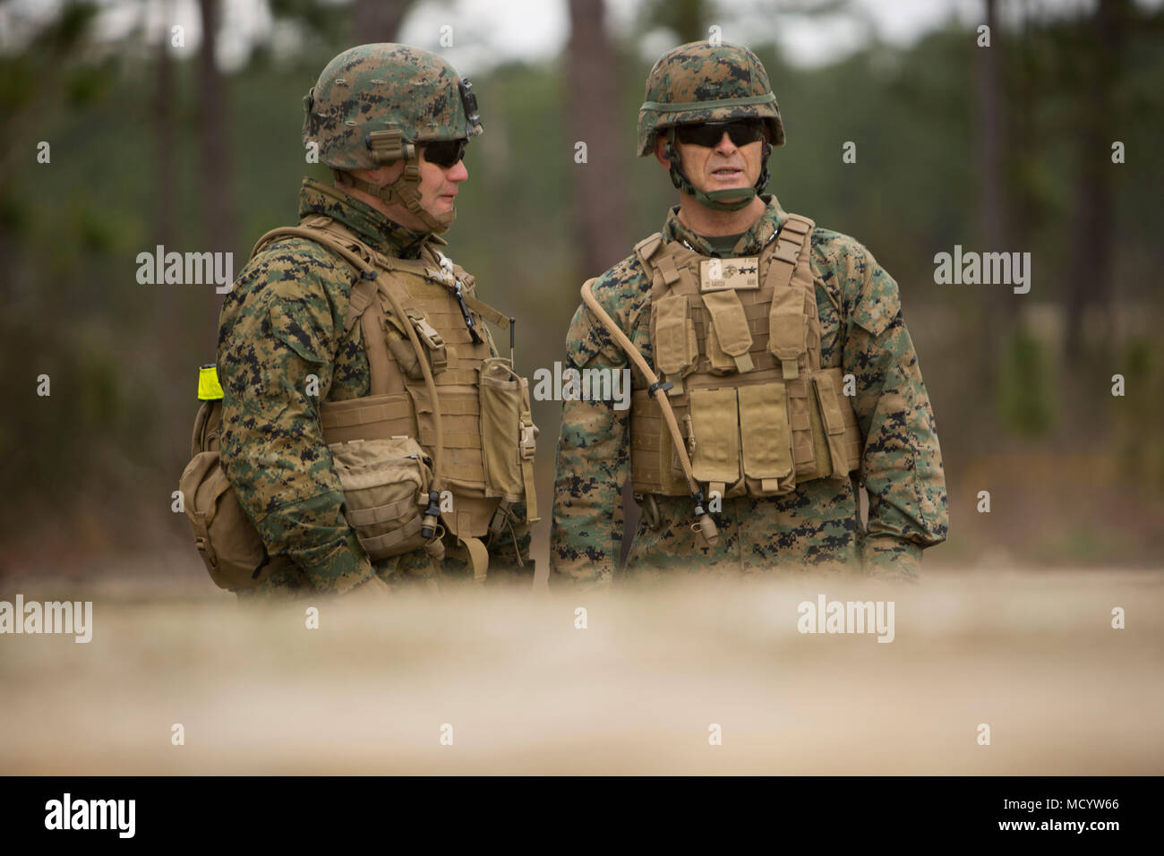 U.S. Marine Corps Maj. Gen. John K. Love, right, 2nd Marine Division Commanding General, observes Marines with 3rd Battalion, 2nd Marine Regiment, 2nd Marine Division, during a live-fire platoon attack at Range G-29 on Camp Lejeune, N.C., March 7, 2018. 2nd Marine Division provided funding and material for the creation of Range G-29 and tasked Marines with 2nd Combat Engineer Battalion to finalize the production of the range. (U.S. Marine Corps photo by Cpl. Justin X. Toledo). - Stock Image