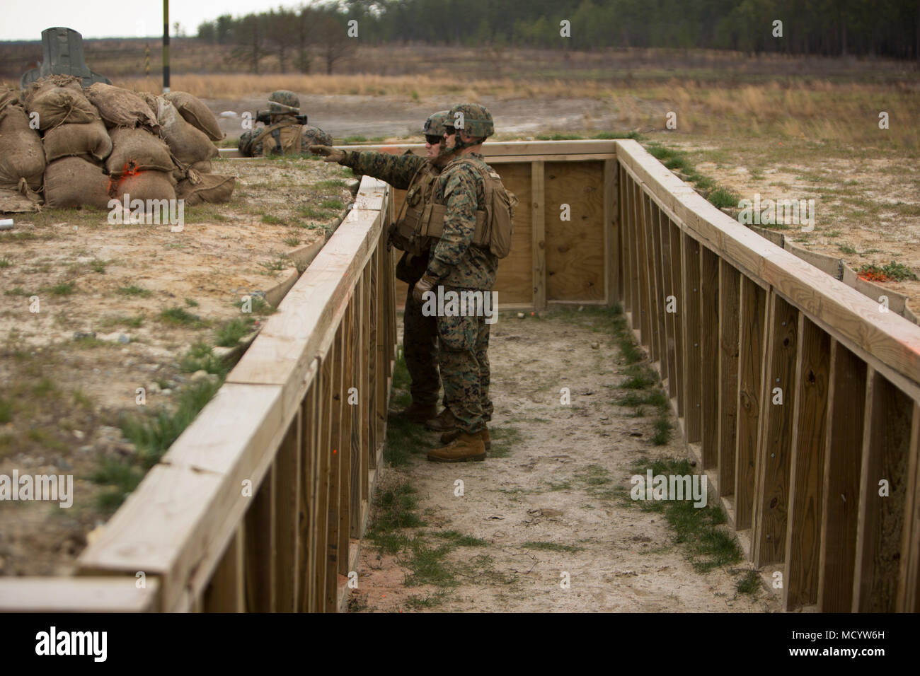 U.S. Marine Corps Maj. Gen. John K. Love, 2nd Marine Division Commanding General, observes Marines with 3rd Battalion, 2nd Marine Regiment, 2nd Marine Division, during a live-fire platoon attack at Range G-29 on Camp Lejeune, N.C., March 7, 2018. 2nd Marine Division provided funding and material for the creation of Range G-29 and tasked Marines with 2nd Combat Engineer Battalion to finalize the production of the range. (U.S. Marine Corps photo by Cpl. Justin X. Toledo). - Stock Image