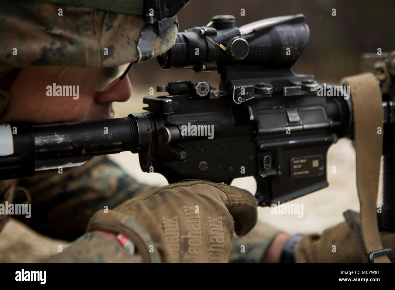 A U.S. Marine with Company L, 3rd Battalion, 2nd Marine Regiment, 2nd Marine Division (2d MARDIV), sights into a M4A1 service rifle while conducting a live fire platoon attack on the new G-29 range  on Camp Lejeune, N.C., March 6, 2018. 2nd Marine Division provided funding and material for the creation of G29, then used 2nd Combat Engineer Battalion equipment and operators to finalize the production of the range. (U.S. Marine Corps photo by Pfc. Nathaniel Hamilton) - Stock Image
