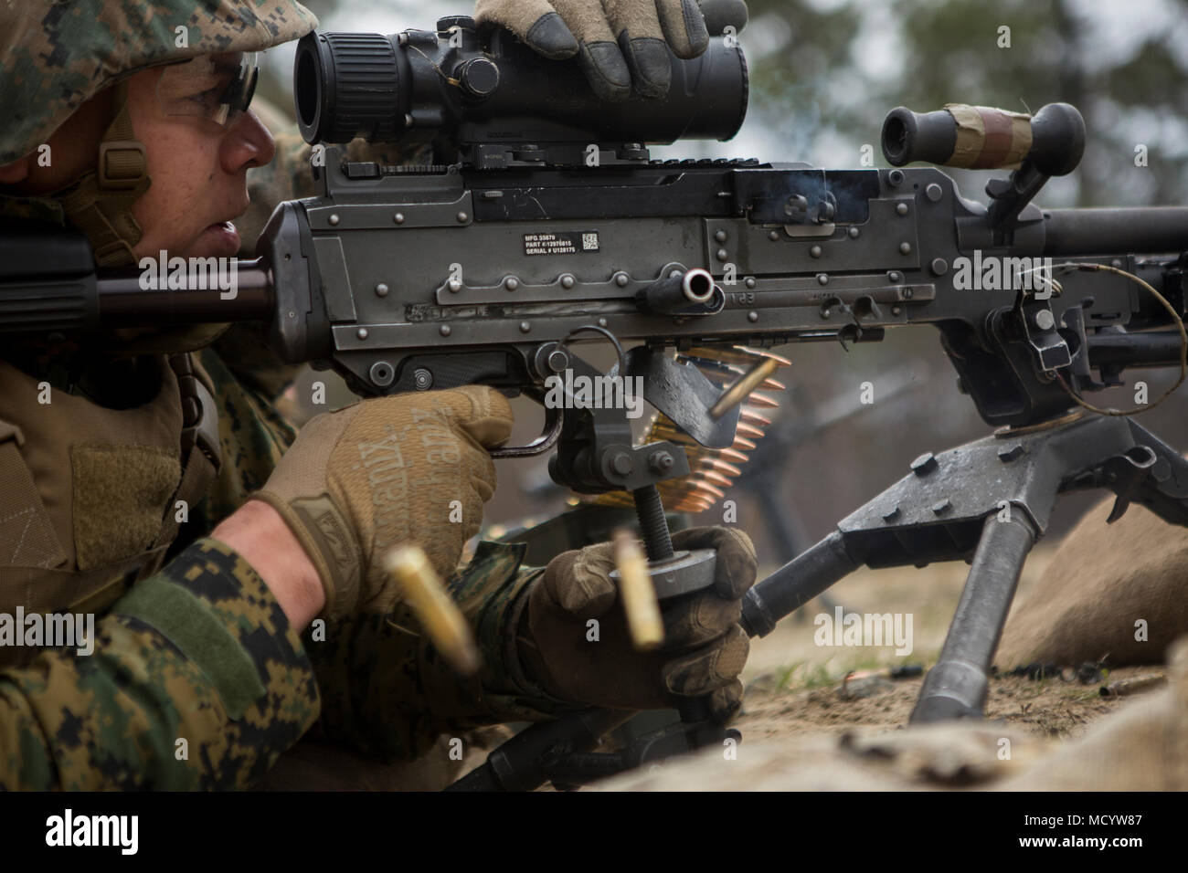 A U.S. Marine with Company L, 3rd Battalion, 2nd Marine Regiment, 2nd Marine Division, fires an M240B machine gun during a live fire platoon attack on the new G29 range on Camp Lejeune, N.C., on March 6, 2018. 2nd Marine Division provided funding and material for the creation of G29, then used 2nd Combat Engineer Battalion equipment and operators to finalize the production of the range. (U.S. Marine Corps photo by Pfc. Nathaniel Hamilton) - Stock Image