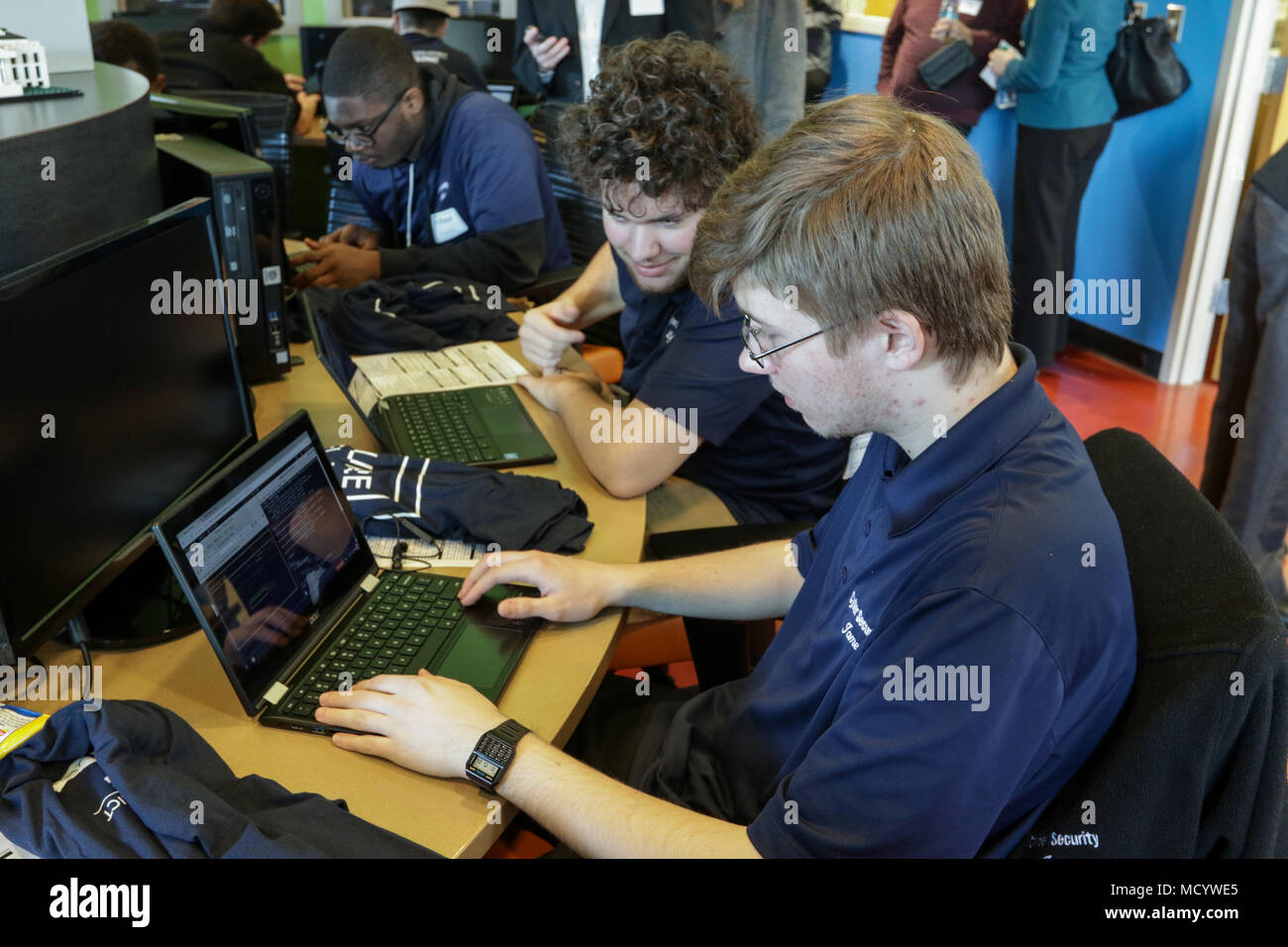 Central Ohio students analyze computer system vulnerabilities during a cyber capture the flag event March 6, 2018, at Westerville North High School in Westerville, Ohio. Sponsored by the Ohio Cyber Collaboration Committee, the event tested students on various cyber security skills to prepare them for potential future careers in technology. (Ohio National Guard photo by Staff Sgt. Michael Carden) - Stock Image