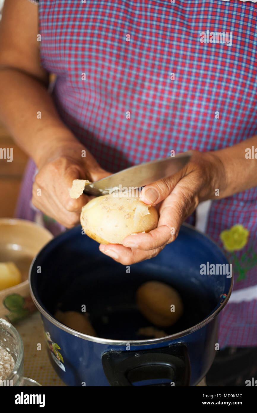 Chef Raquel Patricia Garzon cooking molotes (corn-based fritters stuffed with potato and meat) in her kitchen   Oaxaca City, Oaxaca, Mexico - Stock Image