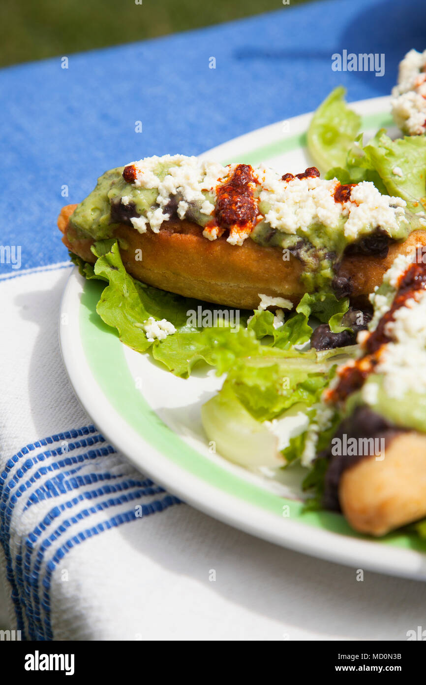 Molotes (corn-based fritters stuffed with potato and meat) in   Oaxaca City, Oaxaca, Mexico - Stock Image