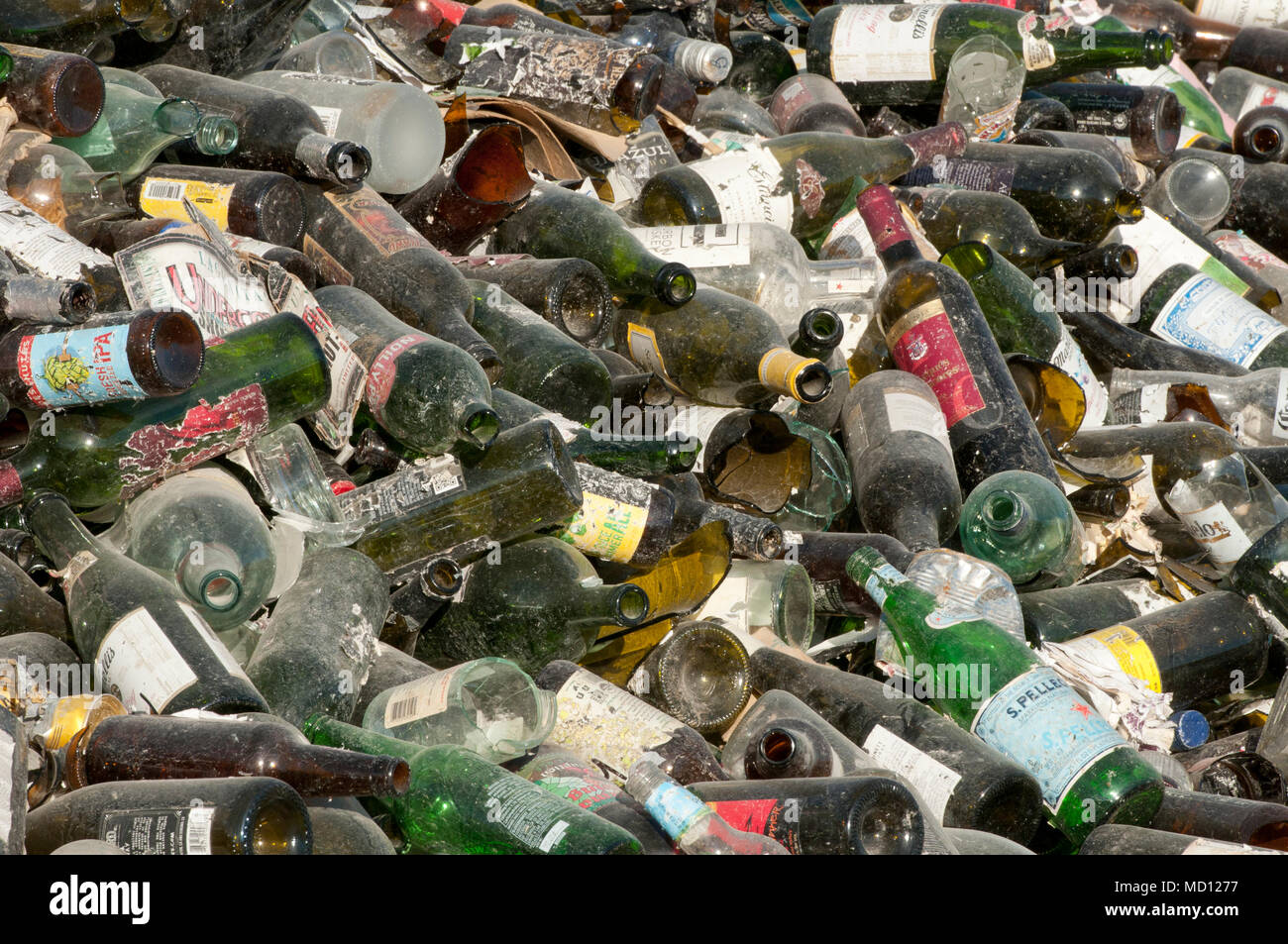Pile of glass bottles to be recycled - Stock Image