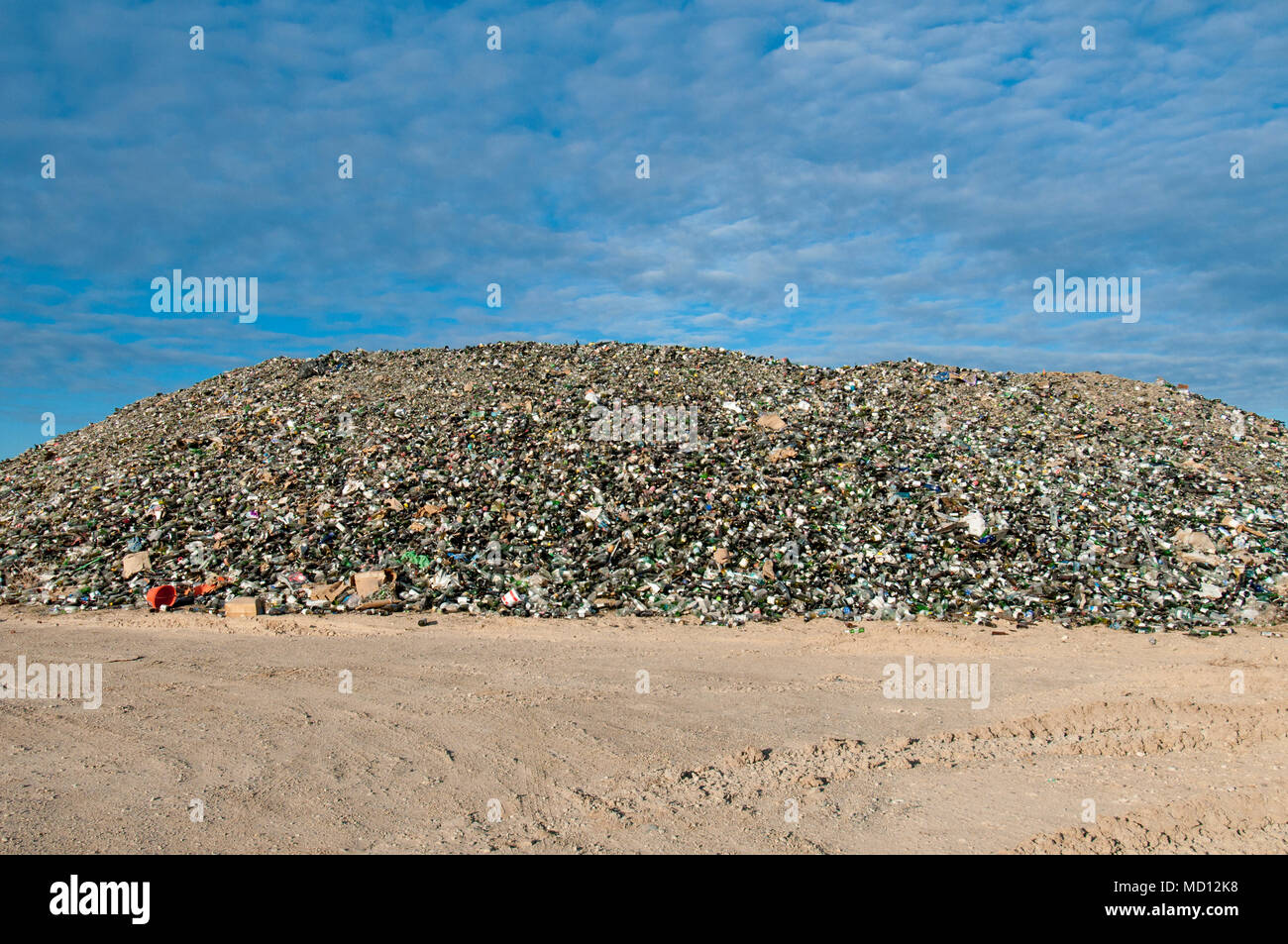 Mountain of glass bottles to be recycled - Stock Image