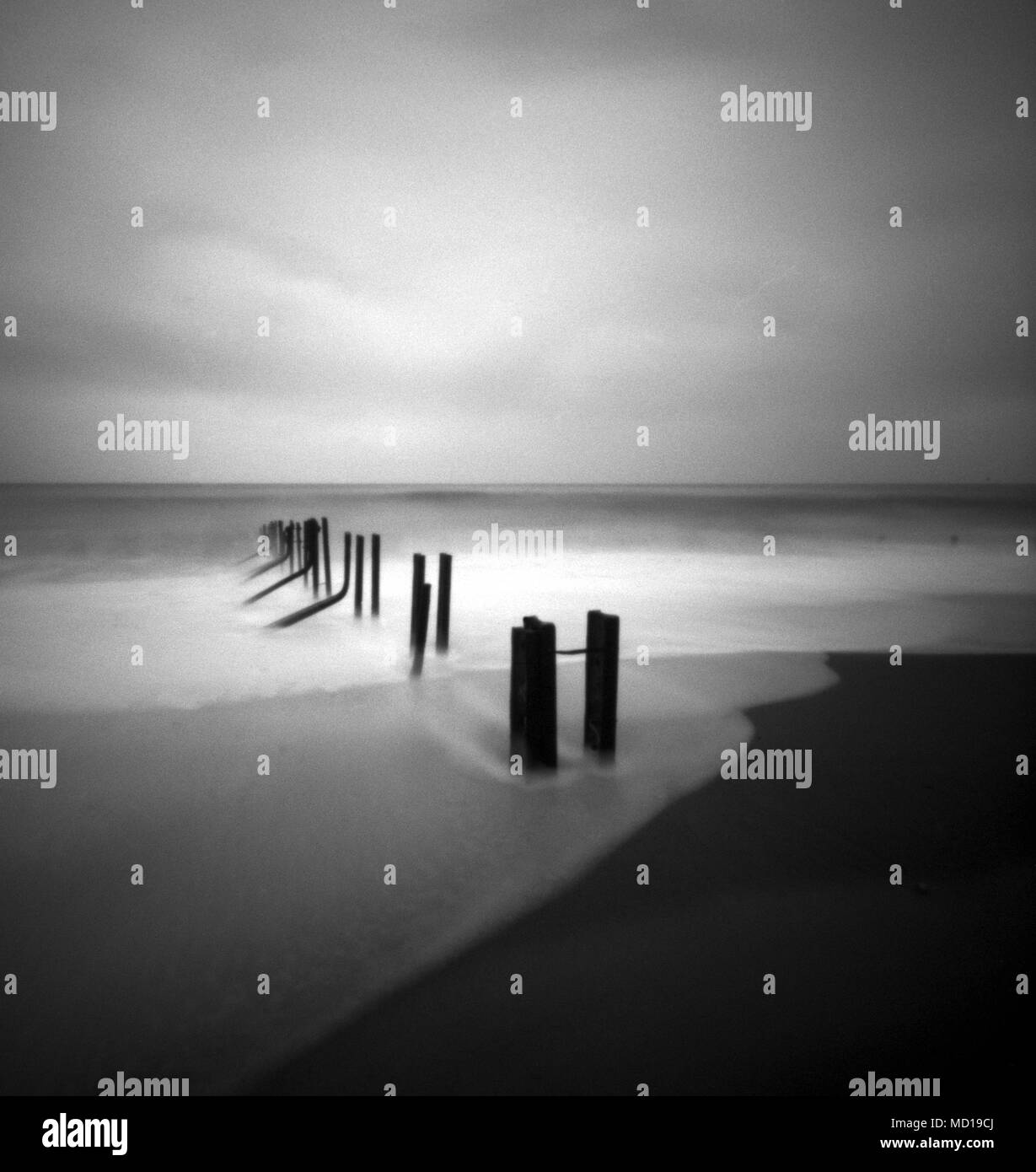 The tide recedes down the beach at Folkestone warren , Kent. Image taken with a pinhole camera. - Stock Image