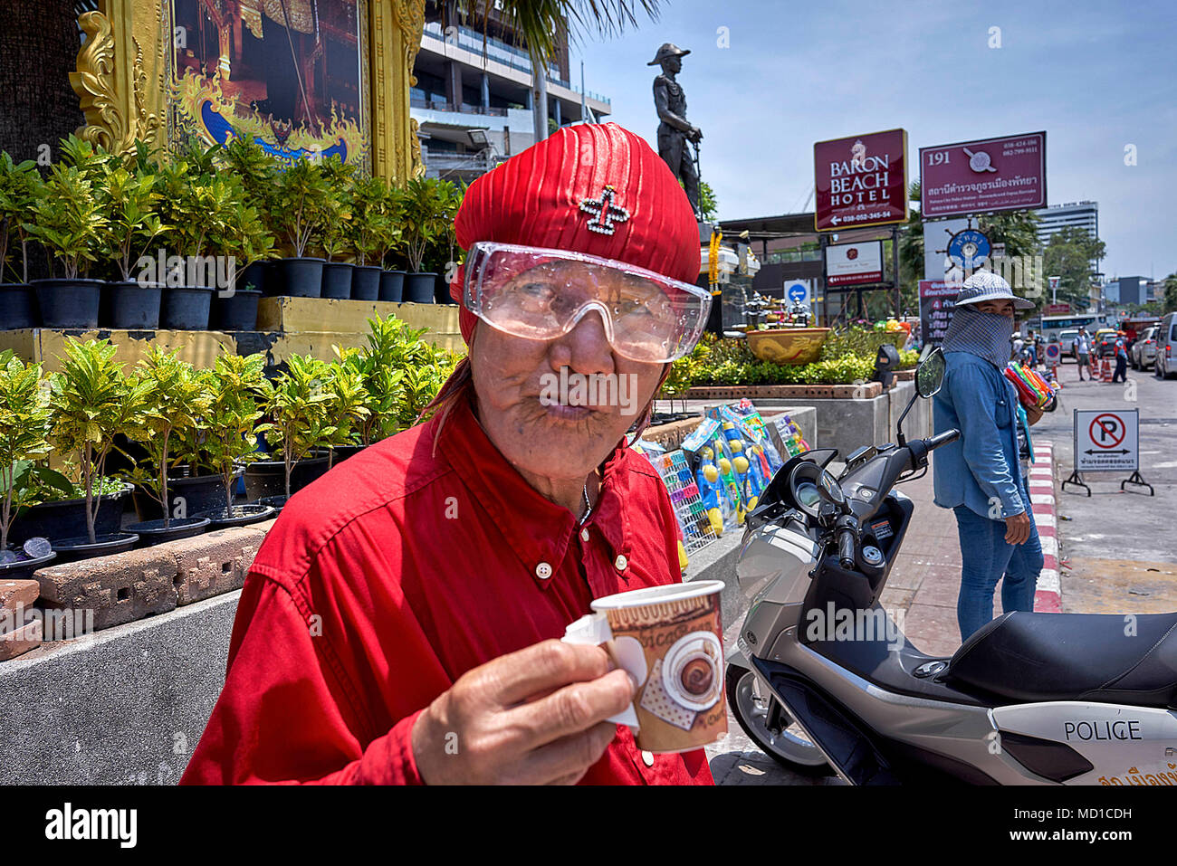 Songkran reveller. Thailand man wearing goggles and unusual clothing at the Thai water festival event. - Stock Image