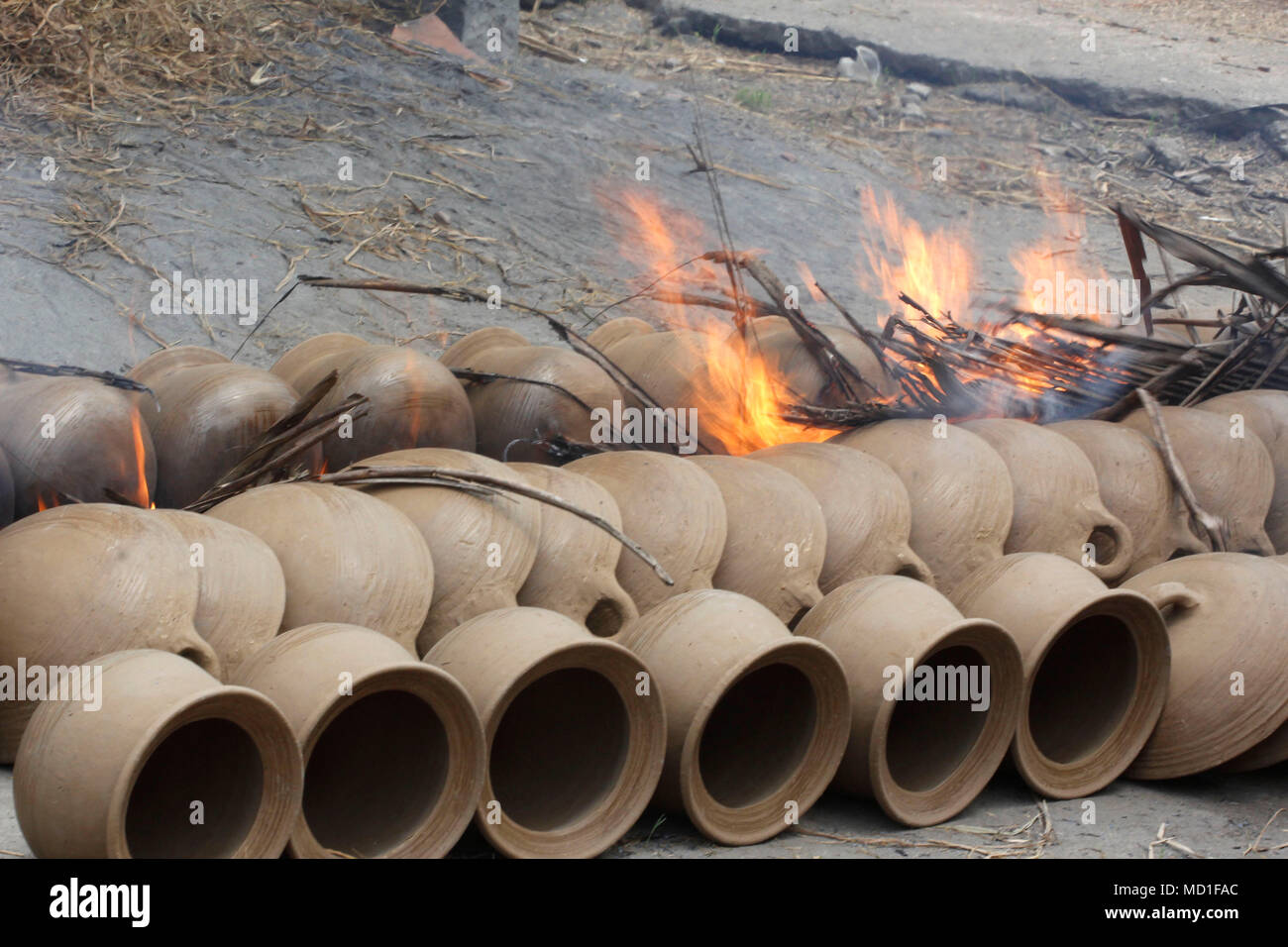 Magelang, Indonesia. 17th Apr, 2018. Earthenware is dried by firing at home industry at Magelang, Center of Java, Indonesia. She earning around 60.000 IDR per day. Credit: Dadang Trimulyanto/Pacific Press/Alamy Live News - Stock Image