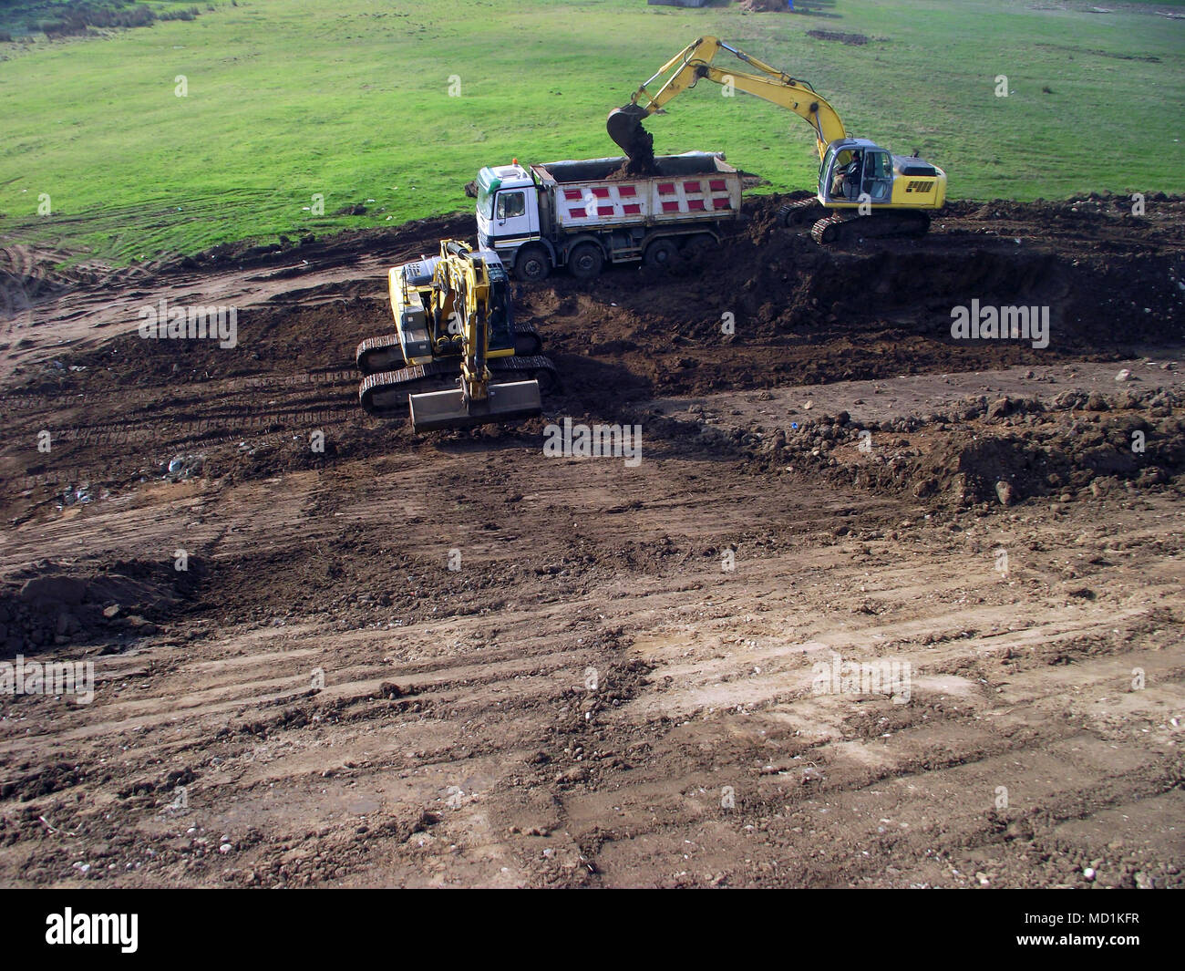 Road construction machinery in activity - Stock Image