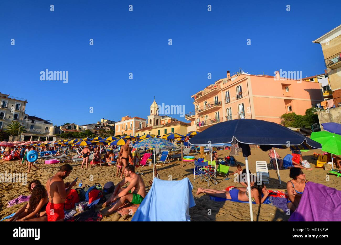 Santa Maria di Castellabate, Campania region, Italy August 15 2016. The beach in the center of the village with houses close to the sea. Stock Photo