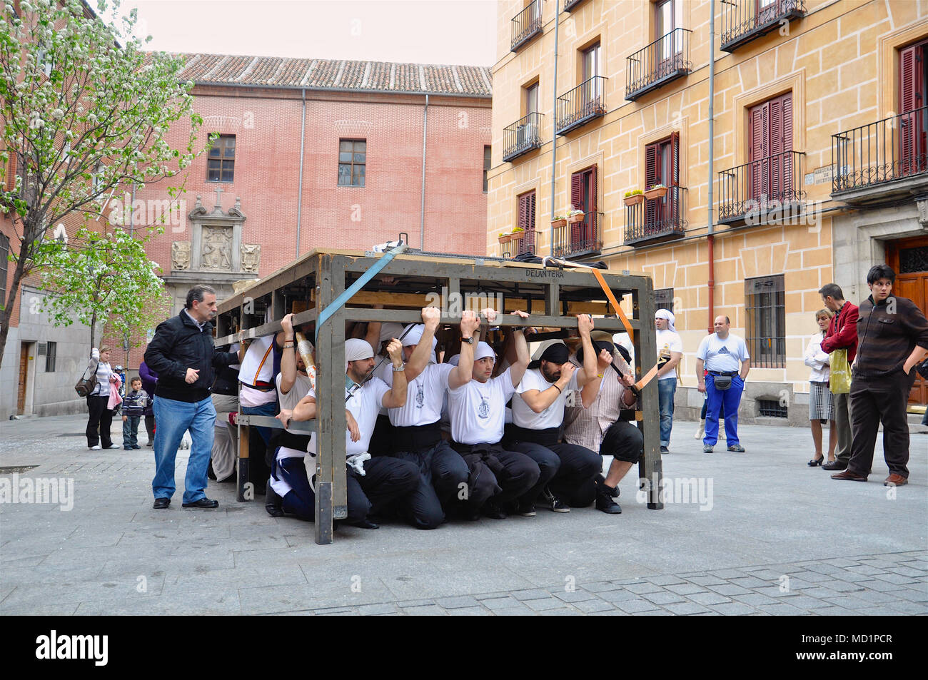 "Gran Poder and Macarena brotherhood practicing the carriage of a ""Paso"" for the Holy Week in Madrid old town (Spain) - Stock Image"