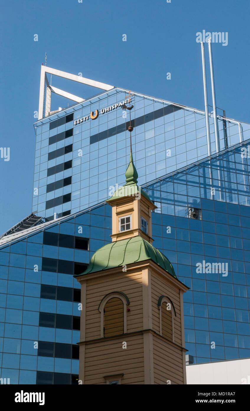 Church against a modern glass facade, Tallin, Estonia. - Stock Image