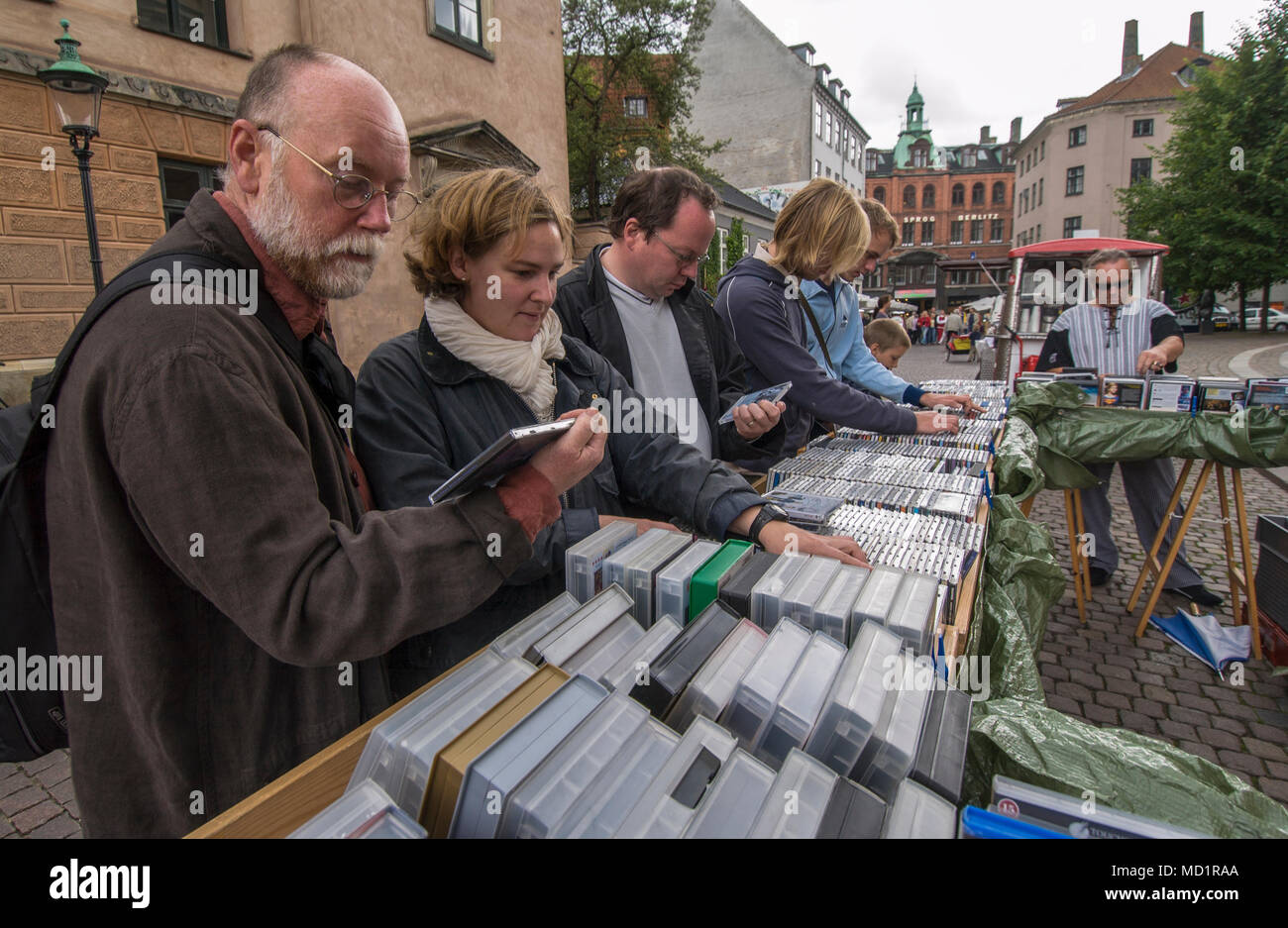 People find out in a flea market, Copenhagen, Denmark. - Stock Image