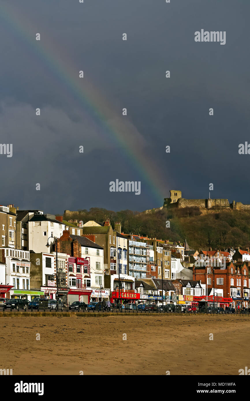 Winter Sunshine And Showers Combine To Produce A Colourful Rainbow Over The  Townu0027s Castle And South Bay Seafront.