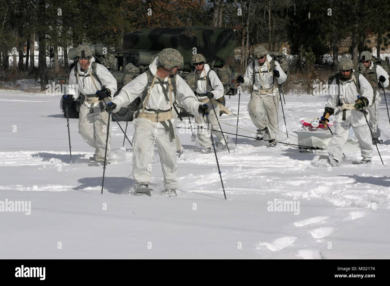 Students In The Cold Weather Operations Course (CWOC) Class 18 06 Practice  Snowshoeing And Pulling An Ahkio Sled During Course Training March 7, 2018,  ...