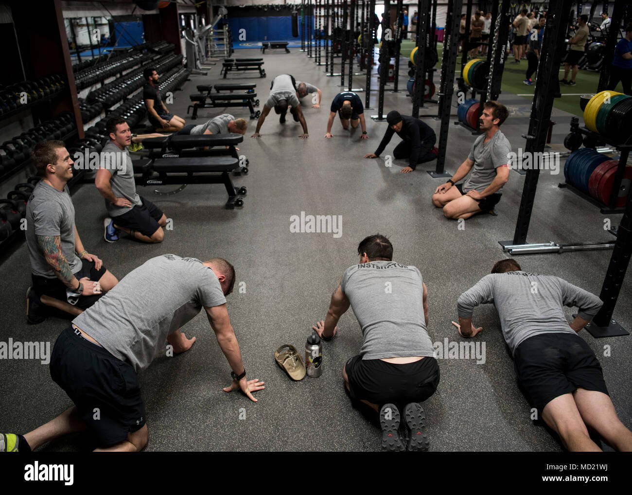 Participants in the Maltz Challenge perform pushups at