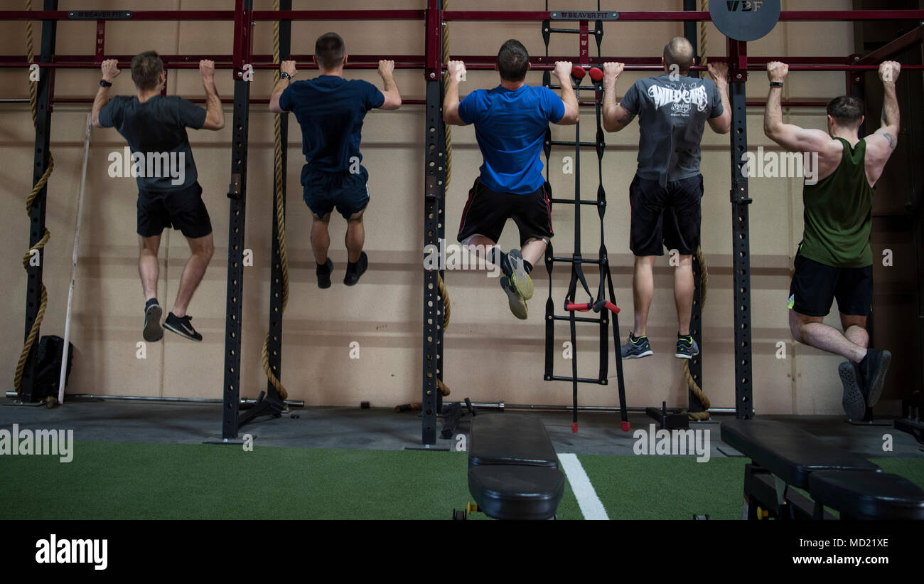 Participants in the Maltz Challenge perform a pullups at
