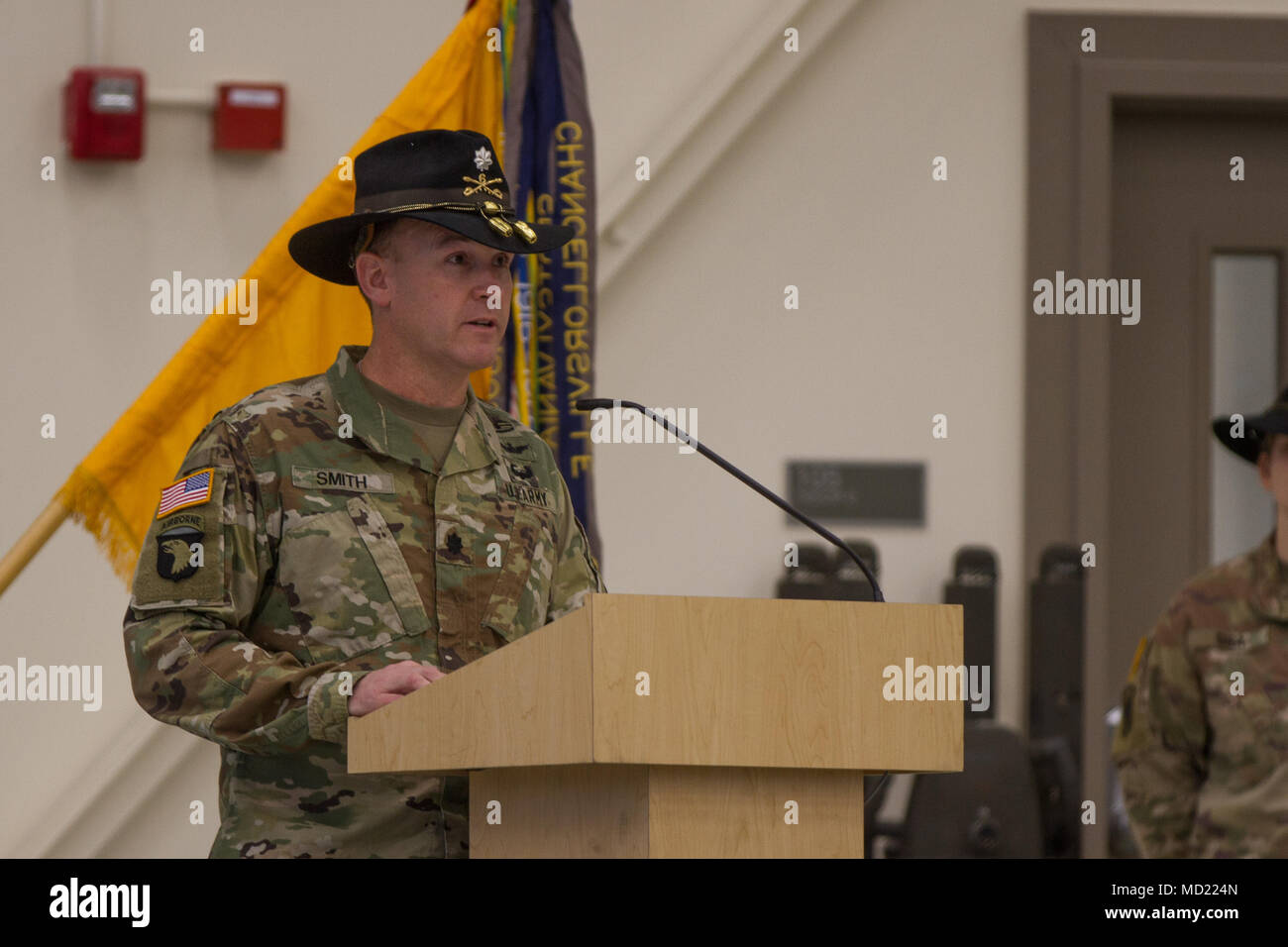U.S. Army Squadron commander Lt. Col. Derek Smith from 4th Heavy Attack Reconnaissance Squadron, 6th U.S. Cavalry Regiment bids farewell to outgoing commander of Headquarters and Headquarters Troop, 4-6 HARS Capt. Michael Bruce from Huckabay, Texas, and welcomes Capt. Tatiana Blanc as HHT's new commander. - Stock Image