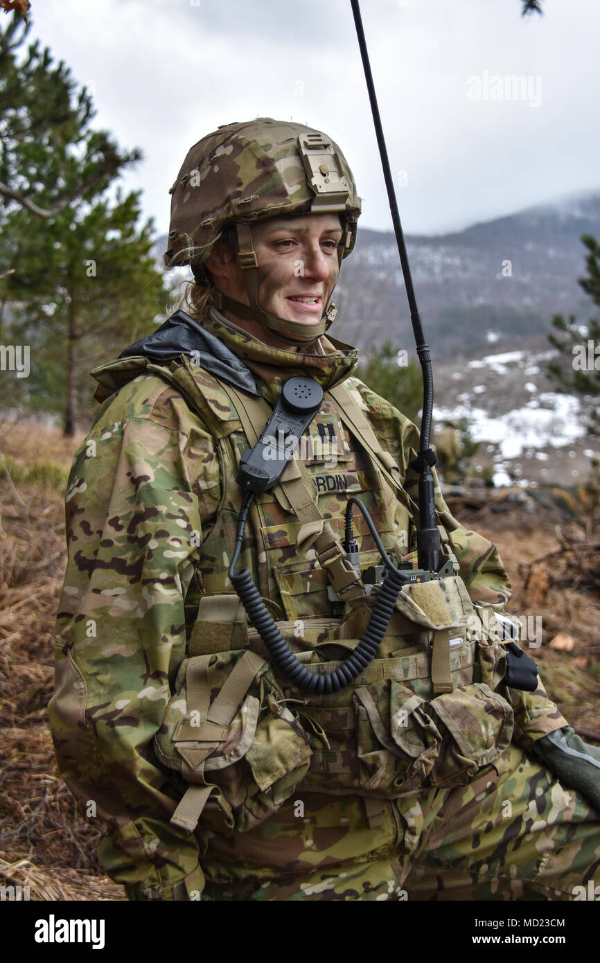 Strong female leaders are present throughout the 173rd Airborne Brigade. Captain Beverly Nordin, both an operations officer and jumpmaster, is instrumental in the SkySoldiers of the 173rd Airborne Brigade getting to the battlefield and destroying our enemies when they get there. - Stock Image