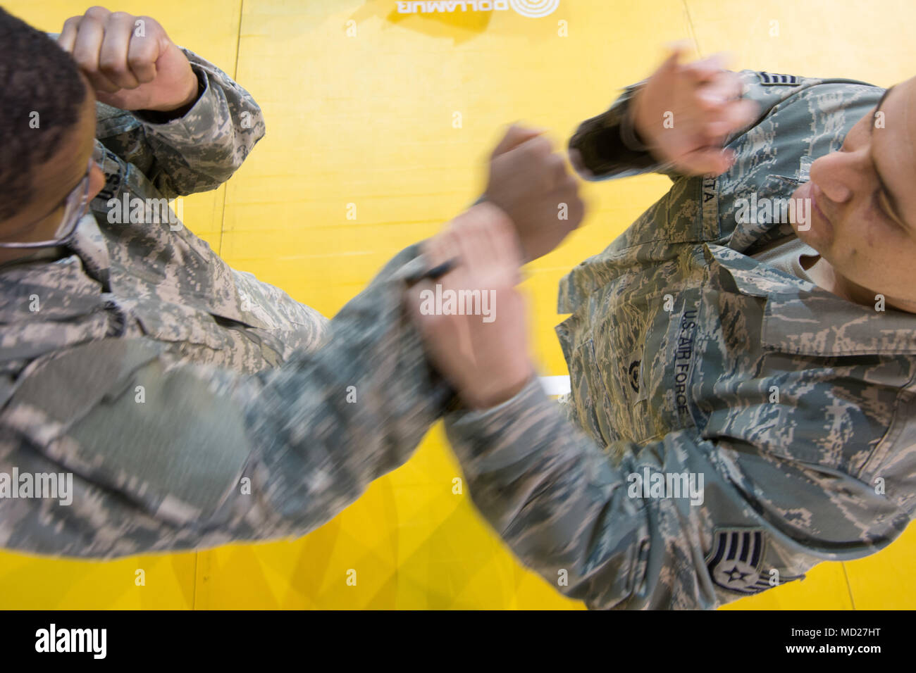U.S. Air Force Staff Sgt. Mario Huerta (right), assigned to the SACEUR Security Detachment, describes the jab thrown by U.S. Army  Sgt. Terrance Simmons, with the Northern Law Center, 21st Theater Sustainment Command, throws, during the  Joint Tactical Combatives Course, on Chièvres Air Base, Belgium, March 9, 2018. (U.S. Army photo by Visual Information Specialist Pierre-Etienne Courtejoie) - Stock Image