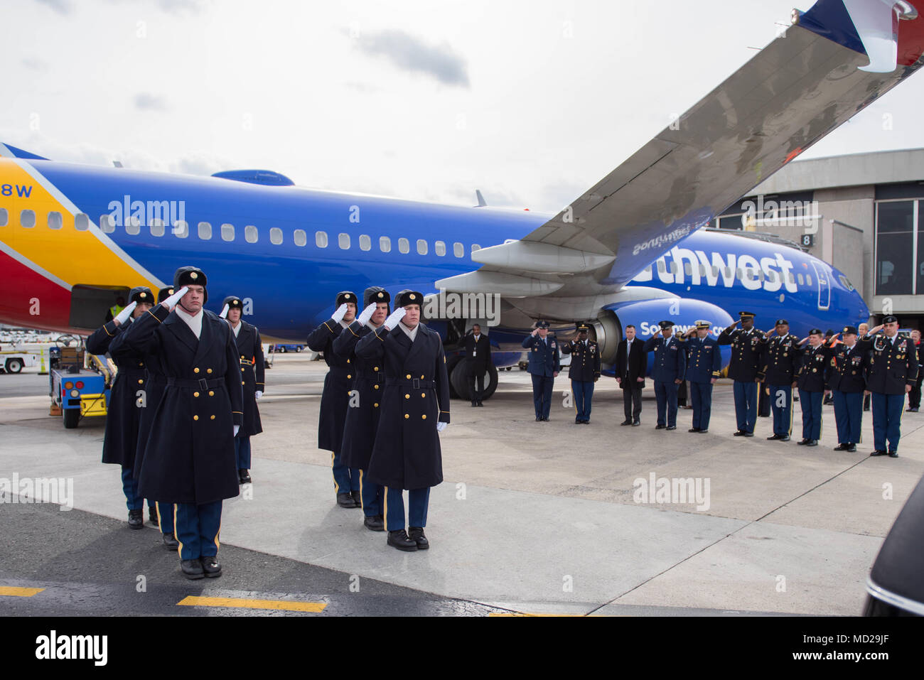 Soldiers assigned to the 3d U.S. Infantry Regiment (The Old Guard), conduct a Plane Side Honors at Ronald Reagan Washington National Airport in Arlington, Va., March 14, 2018. Honors were rendered for Sgt. 1st Class Ryan Kenner who perished while serving on Active Duty. (U.S. Army photos by Spc. Gabriel Silva) - Stock Image