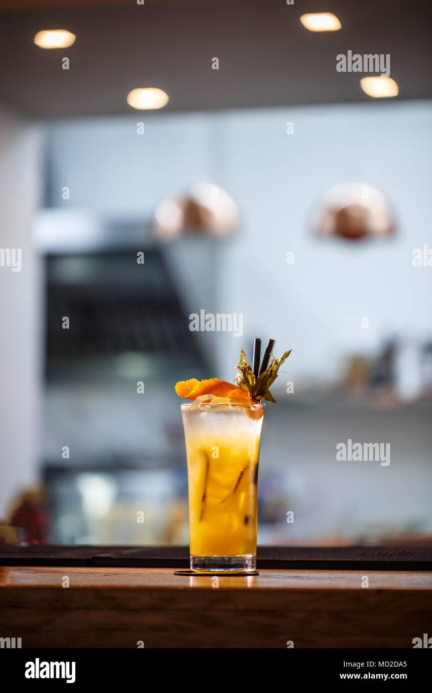 Refreshing cold non-alcoholic summer citrus cocktail with orange, ginger and crushed ice - Stock Image