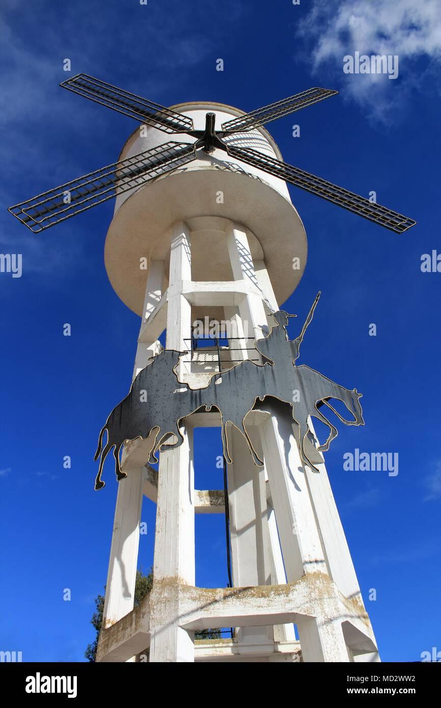 Water tank shaped like a windmill and Quixote picture in Alborea, Castilla la Mancha, Spain - Stock Image