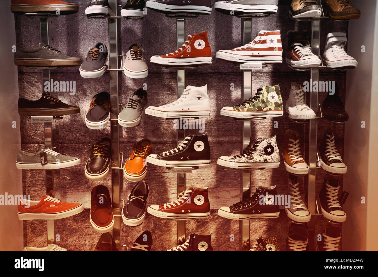 0024a7ae736a Converse trainers and Vans shoes on display - Stock Image