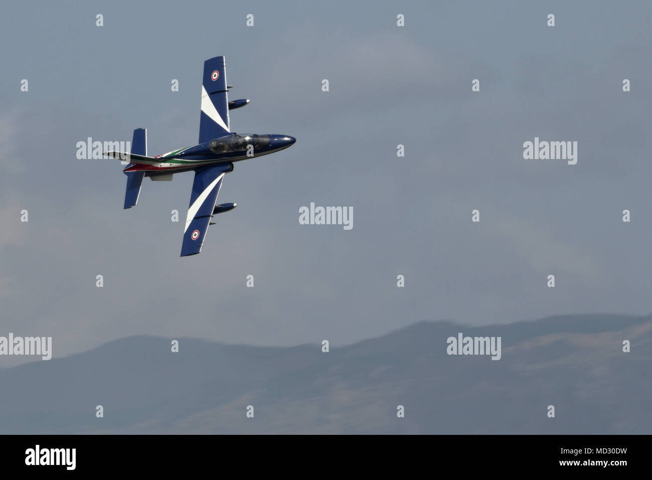 The Italian air force Frecce Tricolori 'Tricolor Arrows' aerobatics team soars over Aviano Air Base, Italy, during an air demonstration for an Italian and American audience on April 16, 2018. The team fly in an Aermacchi MB-339-A/PAN fighter-trainer aircraft performing aerial acrobatics, showing off their colors and expertise. (U.S. Air Force photo by Airman 1st Class Benjamin Cooper) - Stock Image