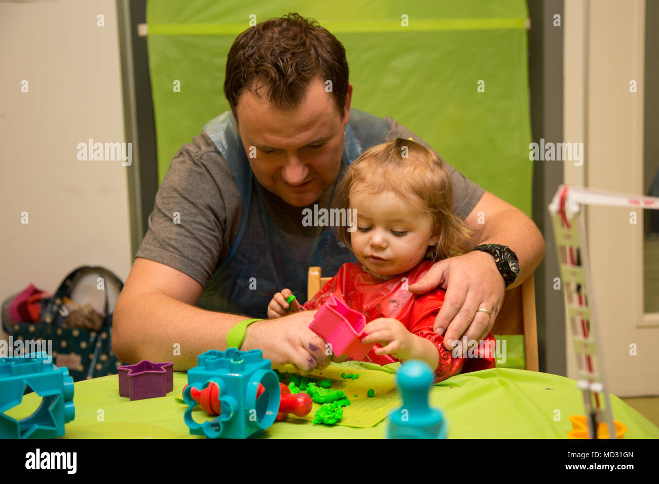 Father and daughter at messy play - Stock Image