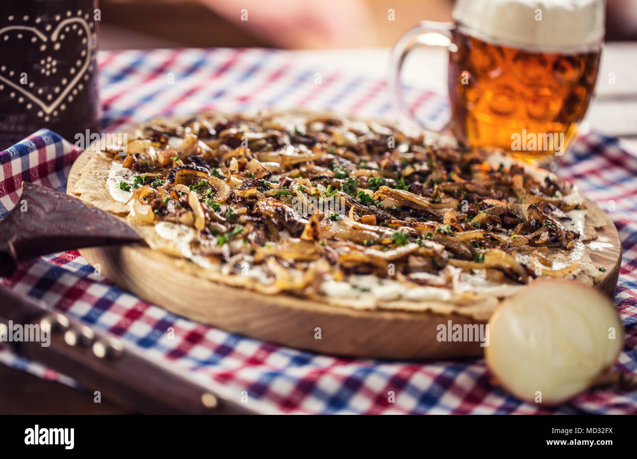 Traditional slovak potato pancake with fried onion bacon and cream with draft beer. - Stock Image