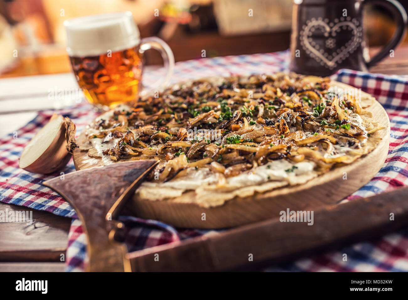 Traditional slovak potato pancake with fried onion bacon and cream with draft beer. Stock Photo