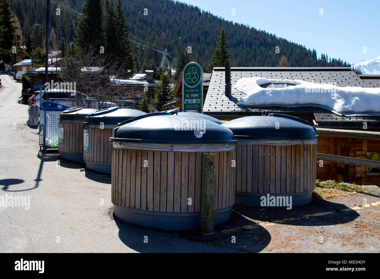 Public Wood trash can bin in verbier switzerland - Stock Image