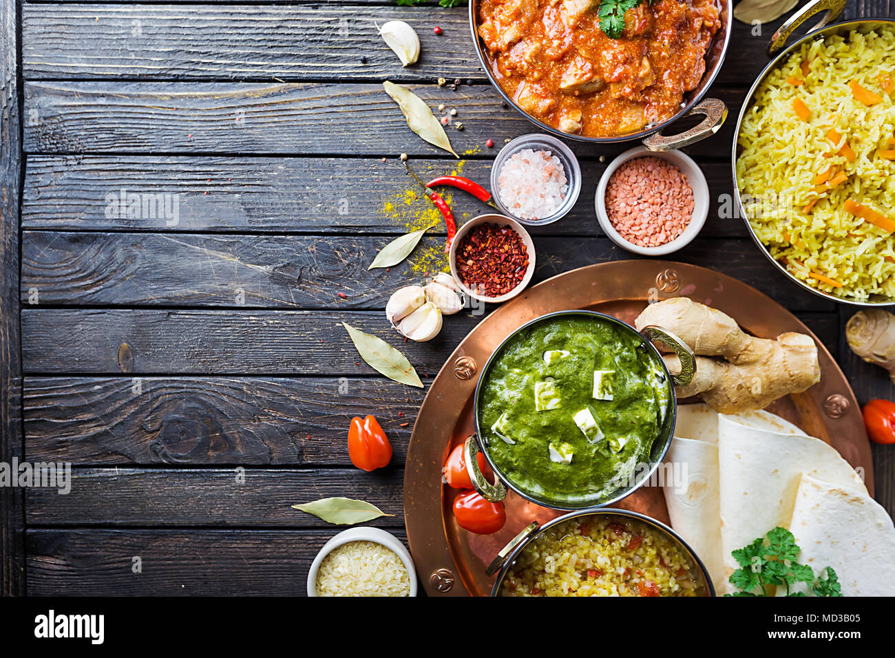 Different bowls with assorted indian food on dark wooden background top view dishes and - Different indian cuisines ...