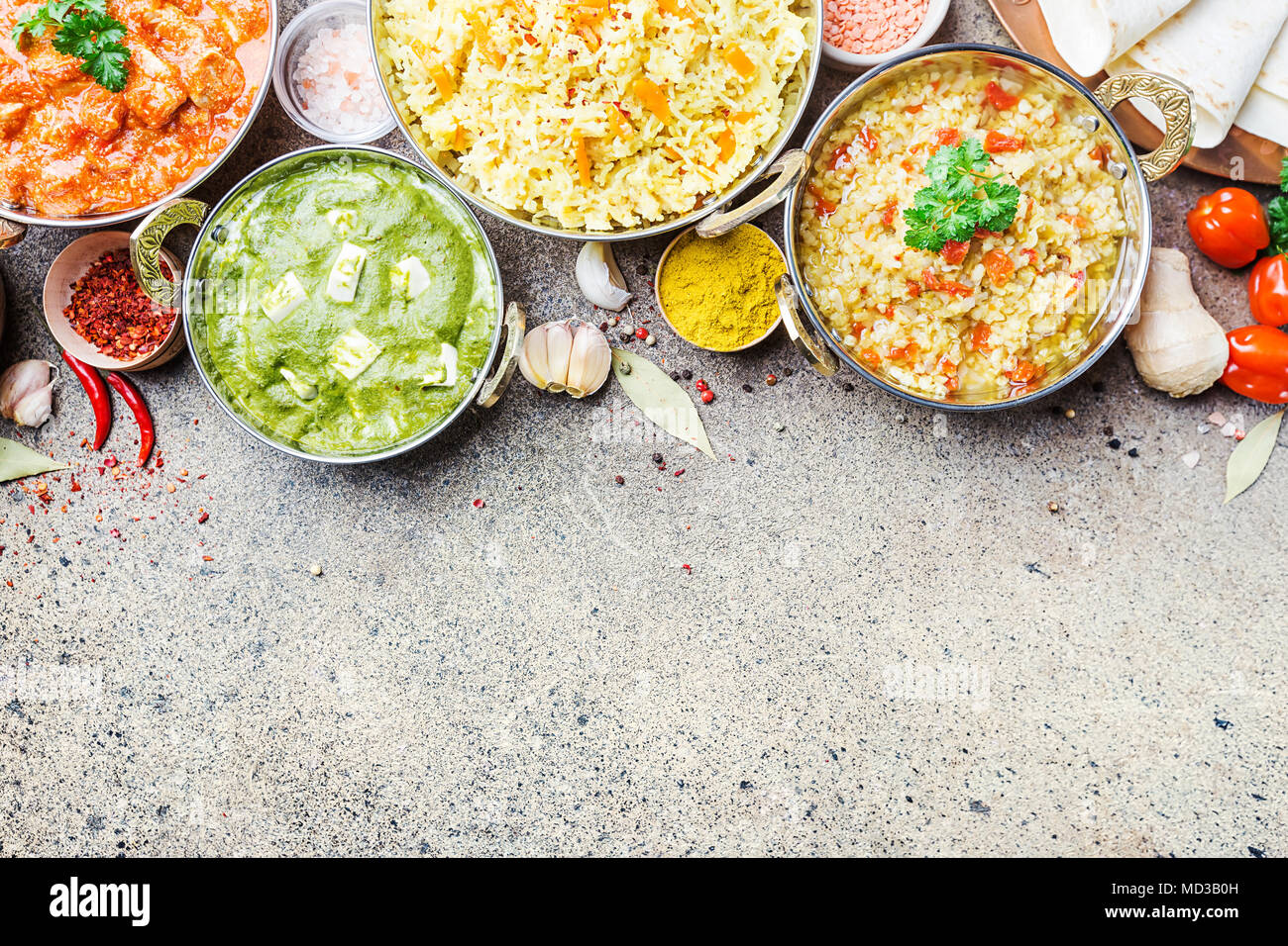 Different bowls with assorted indian food on gray stone background top view dishes and - Different indian cuisines ...