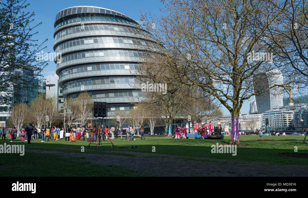 London, UK. 18 April, 2018. London wakes up to warm summer weather and blue skies. A Bollywood film crew shooting scenes at Potters Field Park adjacent to City Hall. Credit: Malcolm Park/Alamy Live News. Stock Photo