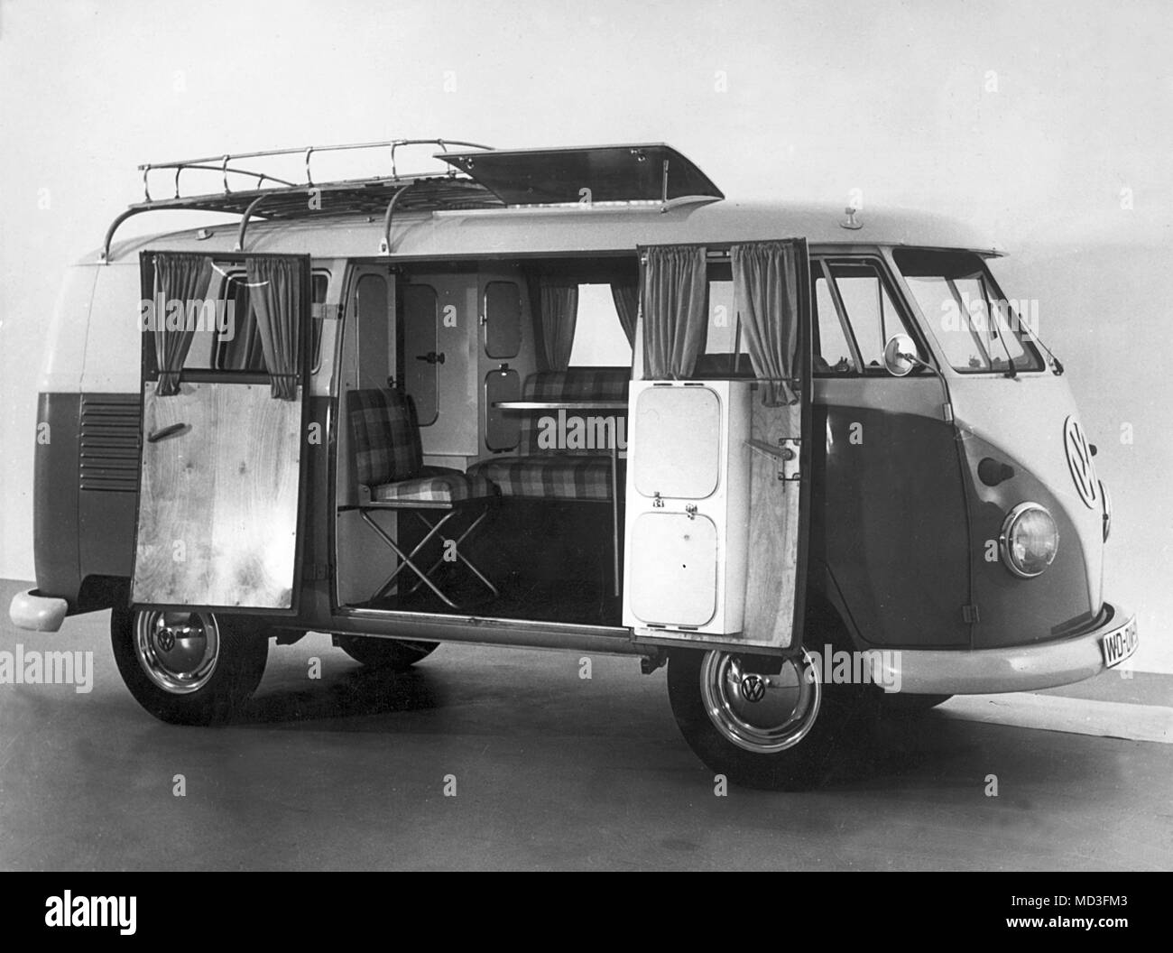 In 1961, the Volkswagen factory included the construction of a camping car in its program. The car will be built from 01.03.1961 in series. The basis is the VW transporter. Its original load space serves as a living room with a table and upholstered seats, which can be converted into a bedroom with just a few simple steps. It also includes a plywood wardrobe, a cooling box, cooking facilities and laundry facilities. An awning in width of the auricula creates additional space. For the accommodation of larger luggage it gives a Dachgepacktrager.     (c) dpa - Report     | usage worldwide - Stock Image