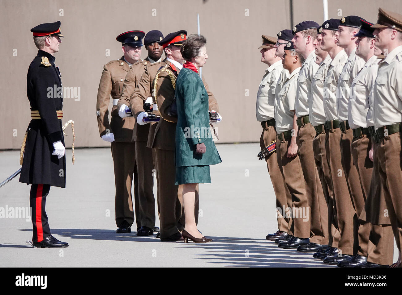 Pirbright Camp, Brookwood. 18th April 2018. The 25th anniversary of the British Army's largest Corps, the Royal Logistics Corps. Her Royal Highness will inspect the first rank of troops before issuing stable belts to 36 of the soldiers on parade. Following the parade The Princess Royal will then be introduced to members of the Corps and their families and learn a little of the recent events and activities regarding the Corps' Silver Jubilee. Her Royal Highness will then join a group photograph on the parade square. Credit: james jagger/Alamy Live News - Stock Image
