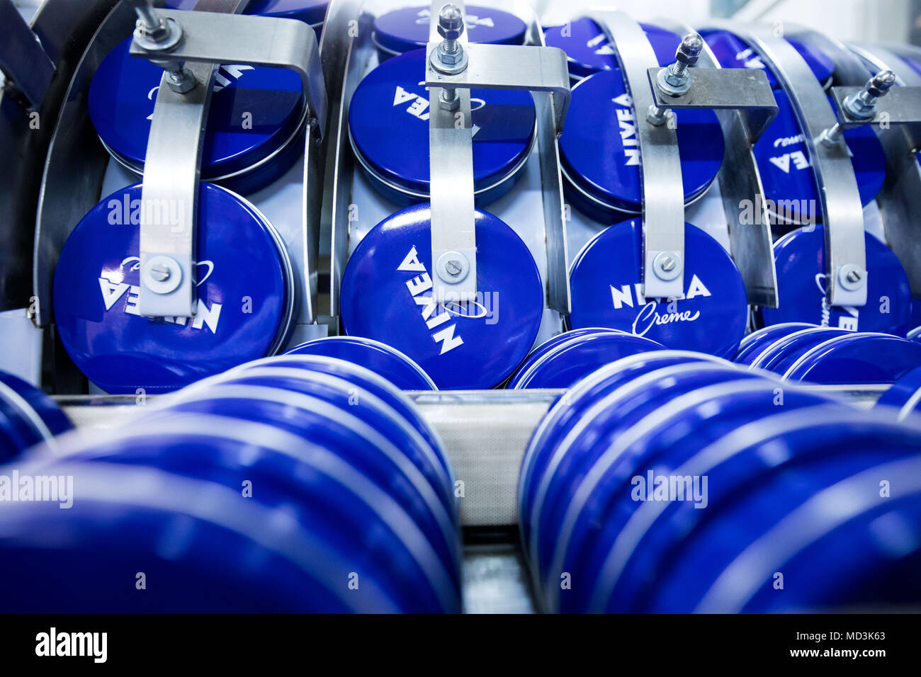 18 April 2018, Germany, Hamburg: Cans of Nivea-Creme at the production plant of the German personal-care company Beiersdorf. Photo: Christian Charisius/dpa - Stock Image