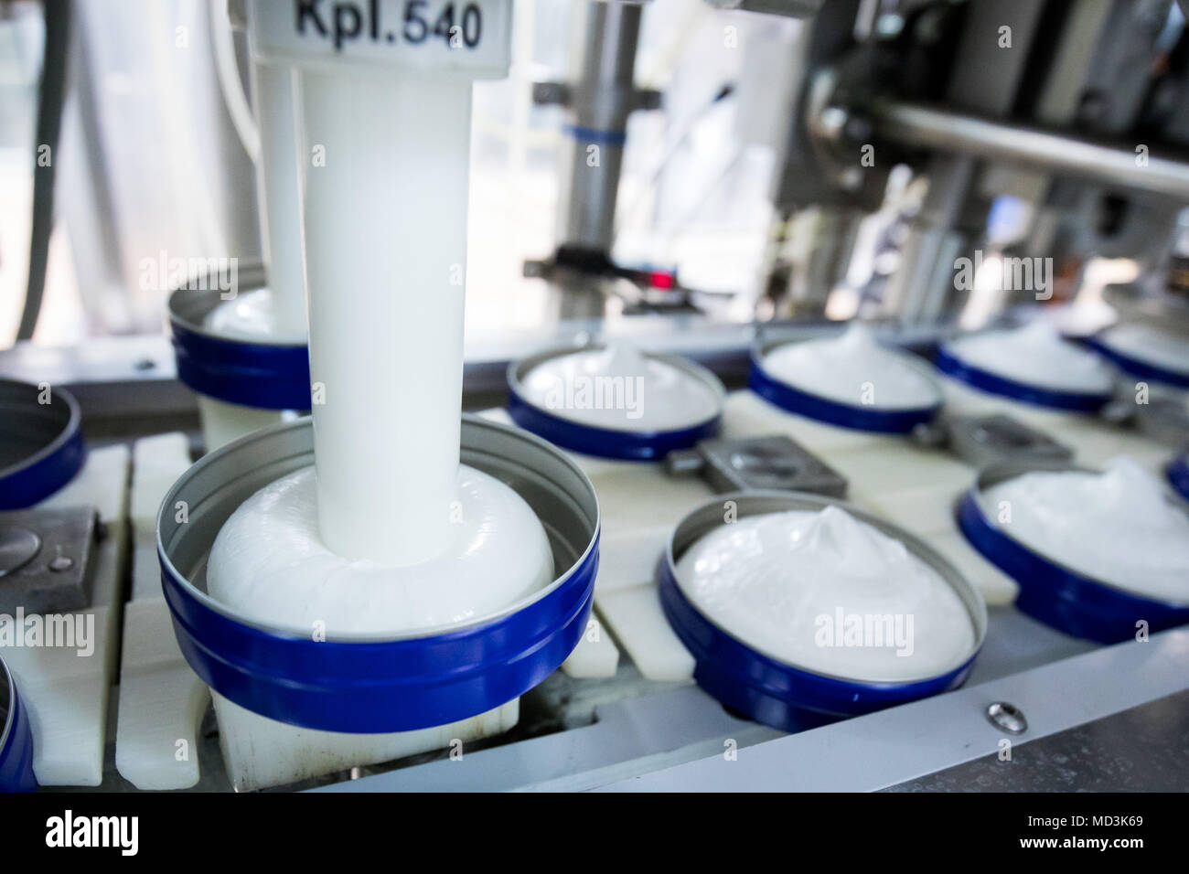 18 April 2018, Germany, Hamburg: Nivea-Creme is being filled at the production plant of the German personal-care company Beiersdorf. Photo: Christian Charisius/dpa - Stock Image