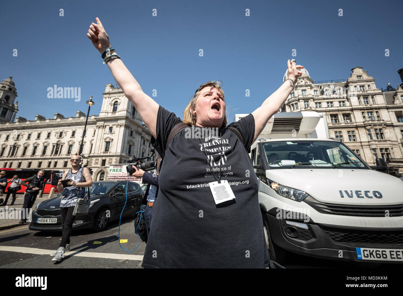 London, UK. 18th April, 2018. Campaigners from DPAC (Disabled People Against Cuts), MHRN (Mental Health Resistance Network) and Black Triangle block the road near Westminster's Parliament buildings on their national day of action in protest to demand the government scrap Universal Credit. Credit: Guy Corbishley/Alamy Live News - Stock Image
