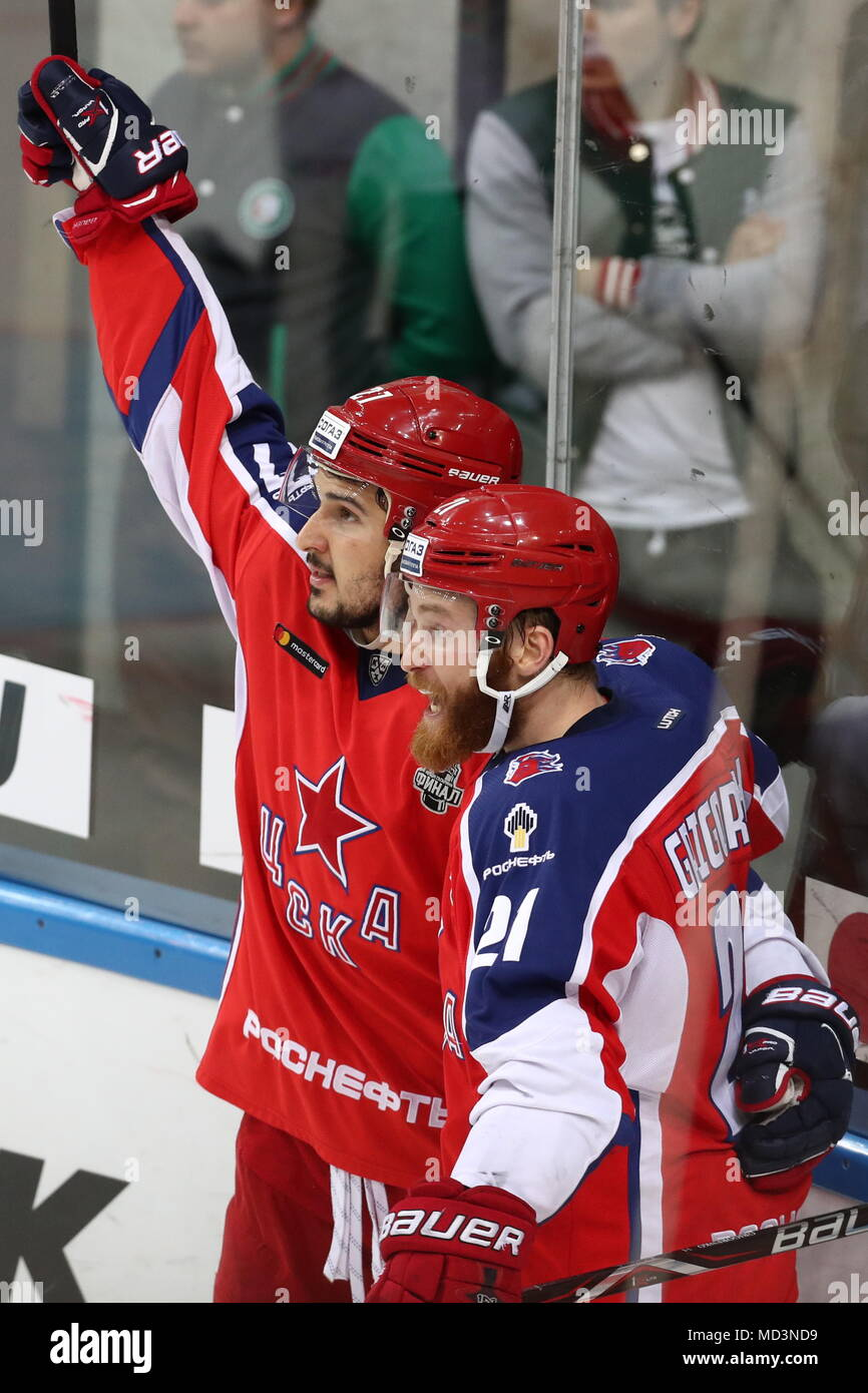 Moscow, Russia. 18th Apr, 2018. MOSCOW, RUSSIA - APRIL 18, 2018: CSKA Moscow's Kirill Petrov (L) and Mikhail Grigorenko celebrate victory in Leg 3 of the 2017/2018 Kontinental Hockey League Gagarin Cup final against Ak Bars Kazan at CSKA Ice Palace. HC CSKA Moscow won the game in extra time. Stanislav Krasilnikov/TASS Credit: ITAR-TASS News Agency/Alamy Live News - Stock Image