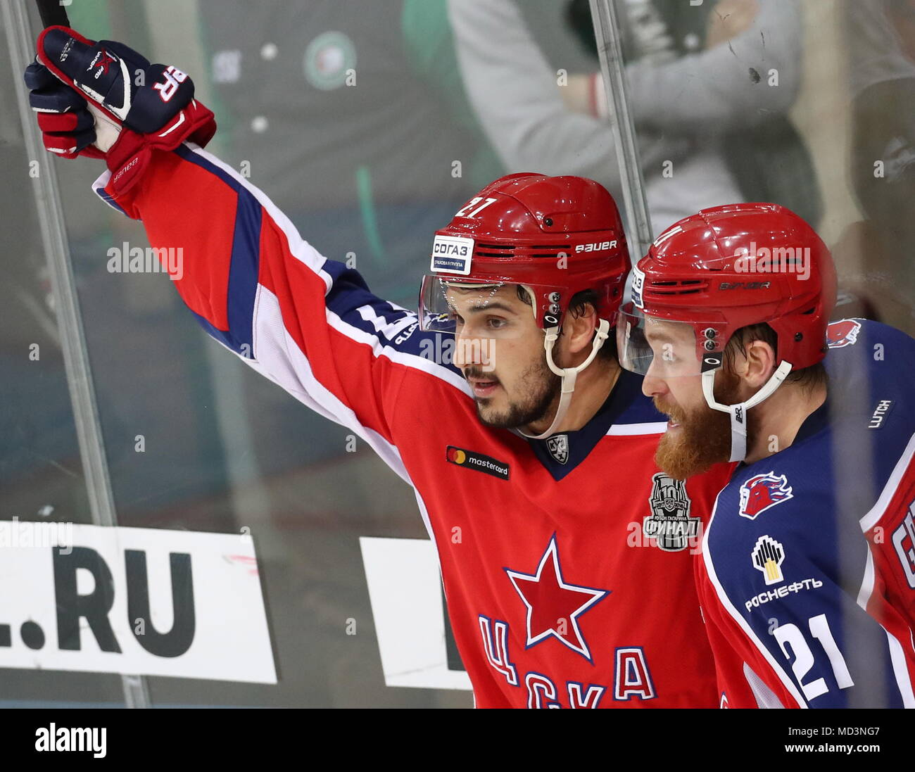 Moscow, Russia. 18th Apr, 2018. MOSCOW, RUSSIA - APRIL 18, 2018: CSKA Moscow's Kirill Petrov (L) and Mikhail Grigorenko celebrate victory in Leg 3 of the 2017/2018 Kontinental Hockey League Gagarin Cup final against Ak Bars Kazan at CSKA Ice Palace. HC CSKA Moscow won the game 3-2 in extra time. Stanislav Krasilnikov/TASS Credit: ITAR-TASS News Agency/Alamy Live News - Stock Image