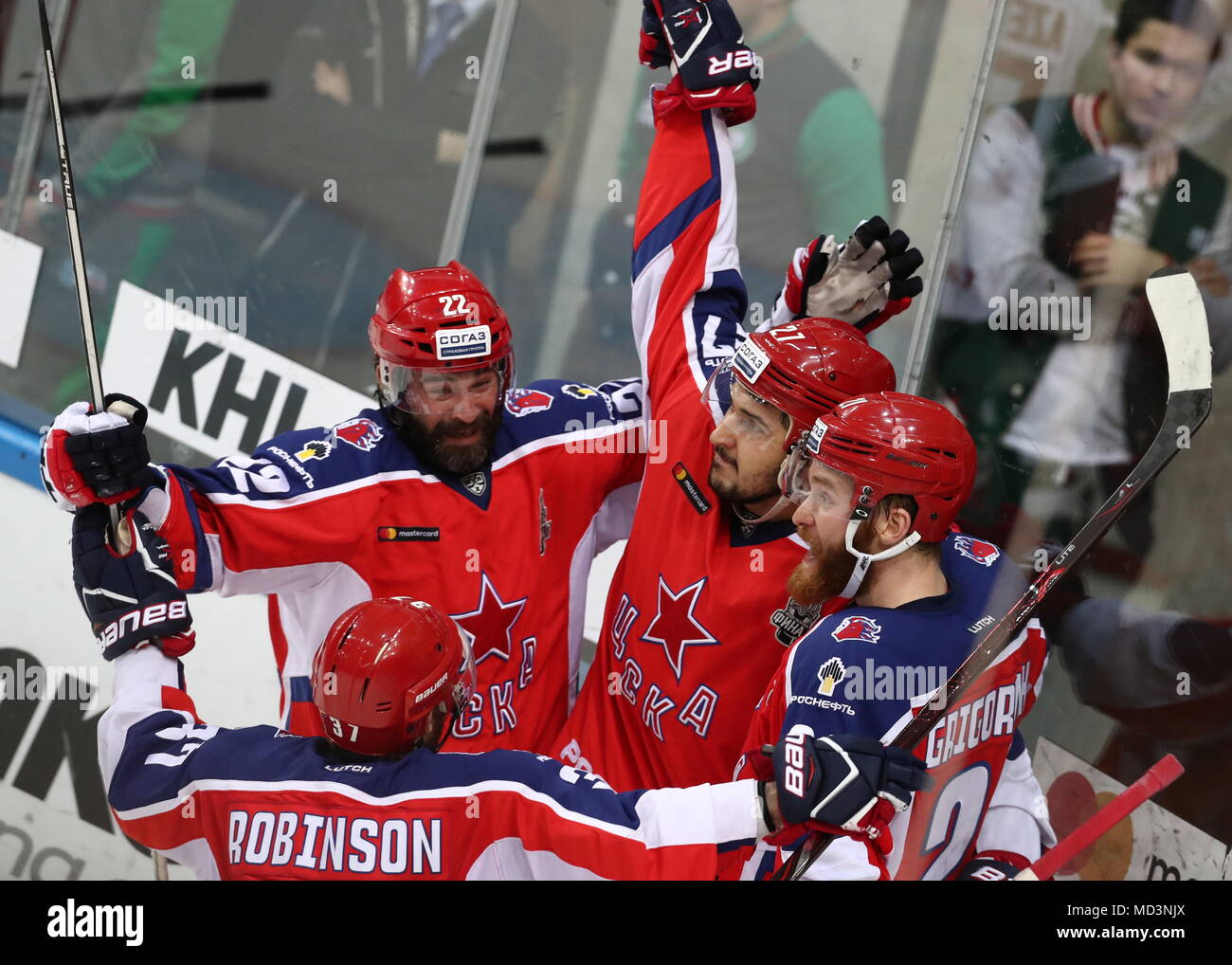Moscow, Russia. 18th Apr, 2018. MOSCOW, RUSSIA - APRIL 18, 2018: CSKA Moscow's Alexander Popov, Kirill Petrov and Mikhail Grigorenko (L-R) celebrate victory in Leg 3 of the 2017/2018 Kontinental Hockey League Gagarin Cup final against Ak Bars Kazan at CSKA Ice Palace. HC CSKA Moscow won the game 3-2 in extra time. Stanislav Krasilnikov/TASS Credit: ITAR-TASS News Agency/Alamy Live News - Stock Image