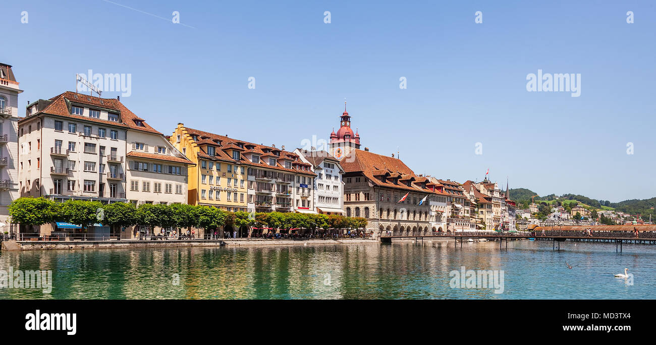 Lucerne, Switzerland - 10 June, 2014: old town buildings along the Reuss river. Lucerne is a city in central Switzerland, it is the capital of the Swi - Stock Image