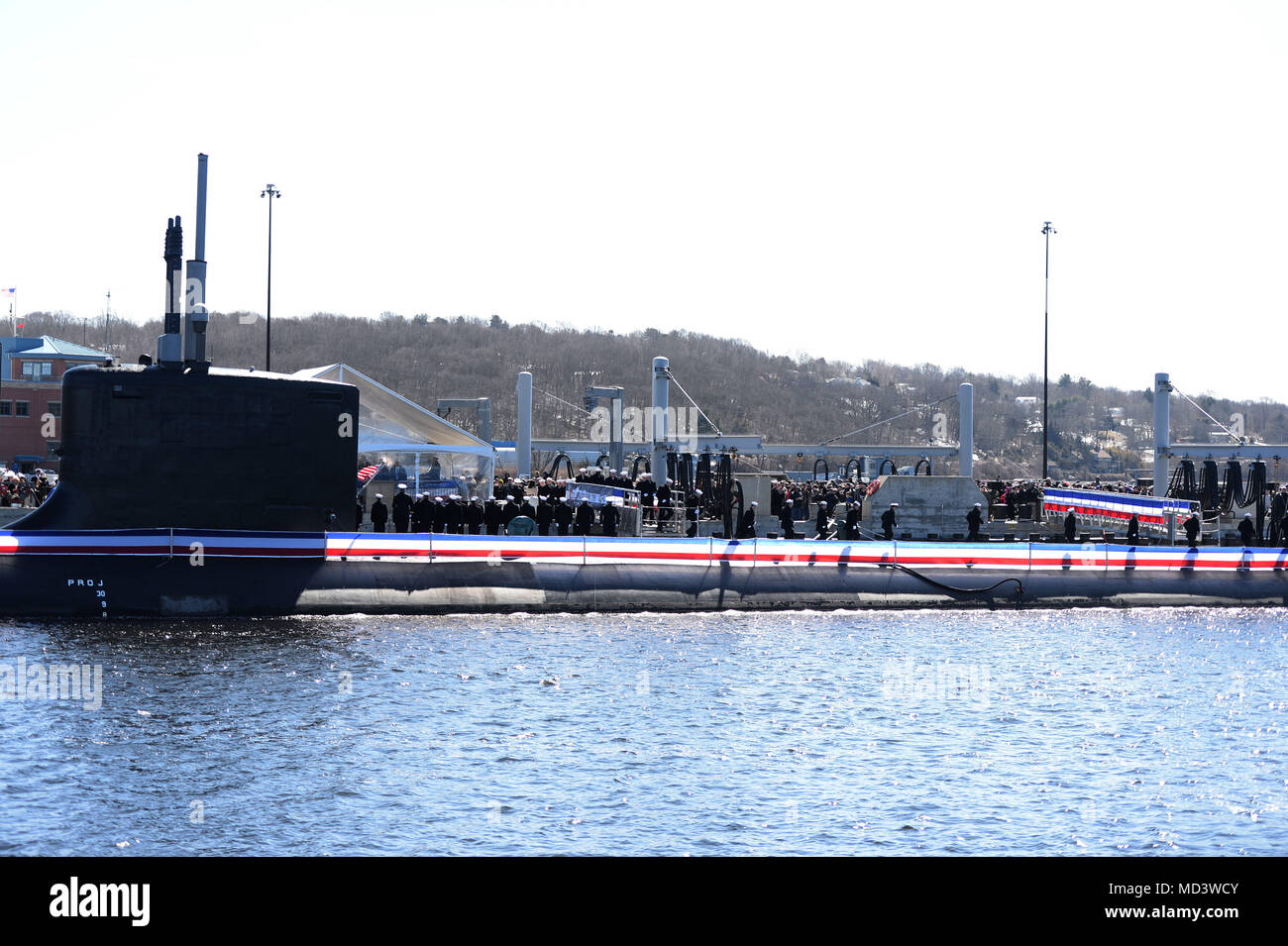 180317-N-LW591-017 GROTON, Conn. (Mar. 17, 2018) Annie Mabus announces 'Bring the Ship to Life' spurring its crew members to race across the brow and fall in formation aboard USS Colorado (SSN 788) during the commissioning ceremony on Naval Submarine Base New London, Mar. 17. USS Colorado is the U.S. Navy's 15th Virginia-Class attack submarine and the fourth ship named for the State of Colorado. (U.S. Navy photo by Mass Communication Specialist 1st Class Steven Hoskins/Released) - Stock Image