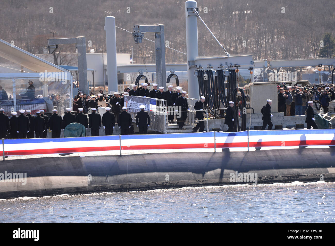 180317-N-LW591-022 GROTON, Conn. (Mar. 17, 2018) Annie Mabus announces 'Bring the Ship to Life' spurring its crew members to race across the brow and fall in formation aboard USS Colorado (SSN 788) during the commissioning ceremony on Naval Submarine Base New London, Mar. 17. USS Colorado is the U.S. Navy's 15th Virginia-Class attack submarine and the fourth ship named for the State of Colorado. (U.S. Navy photo by Mass Communication Specialist 1st Class Steven Hoskins/Released) - Stock Image